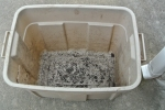 My 36 Quart Rubbermaid bin ready to be cleaned our for my worms. The holes drilled in the bottom to allow air in for the worms also work as drain holes for potato growing. Double use again.