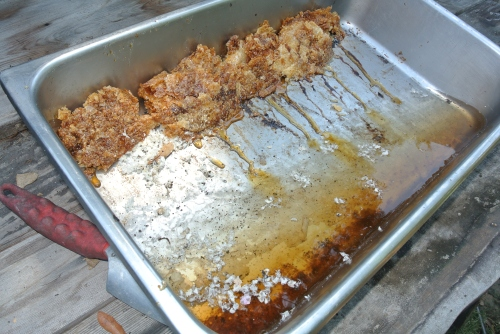 I mash the wax up on the top side of the SS pan. Still a bit of honey oozing out. Tomorrow the wax will be sitting on top of the water.