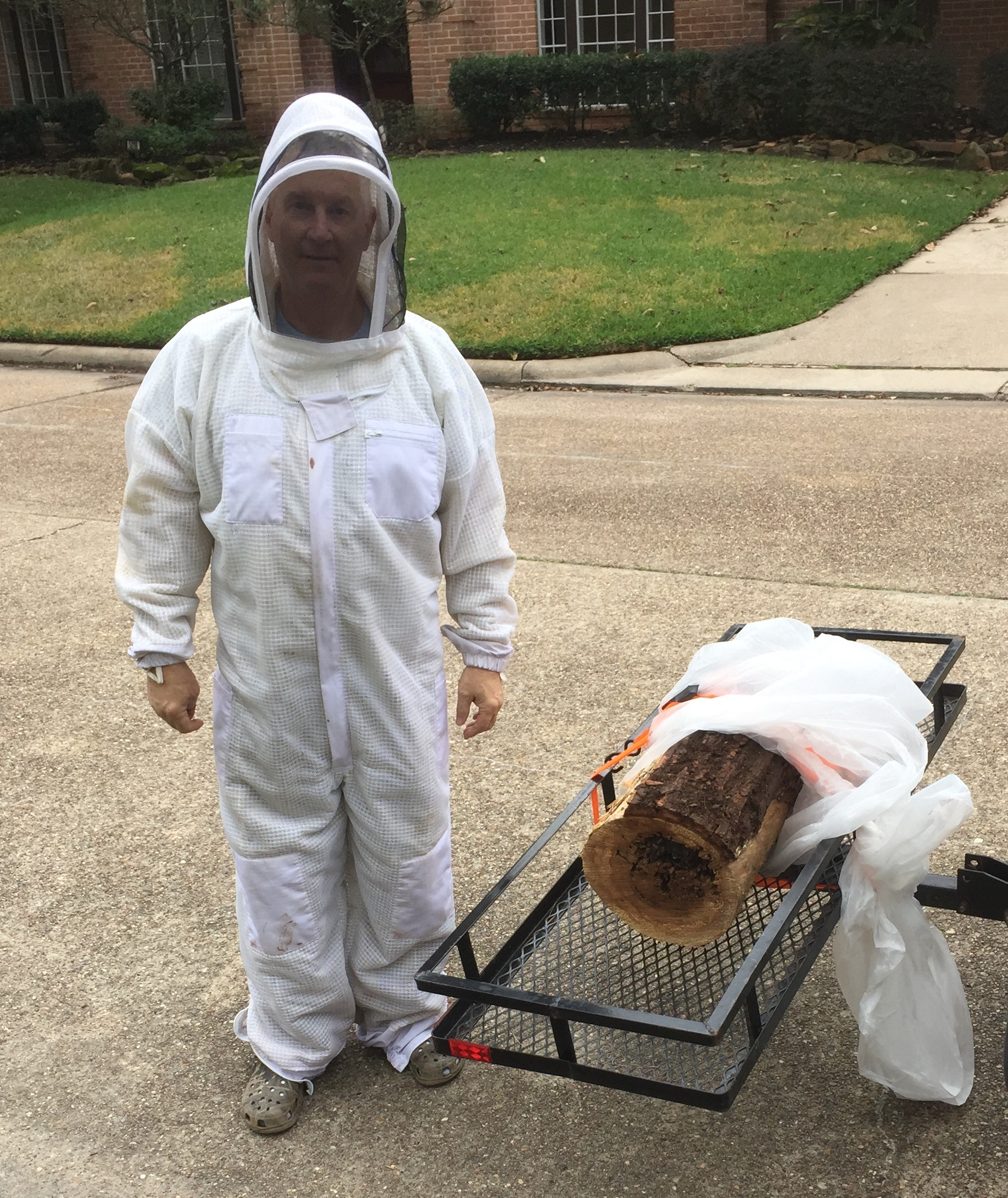 Suited up - the end of the section is open to the colony. Bees were buzzing before I secured the end. Suit is in the wash.....again